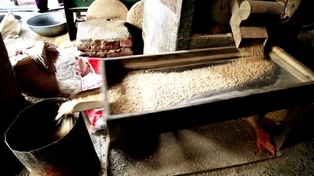 rice harvesting - husking stock videos & royalty-free footage
