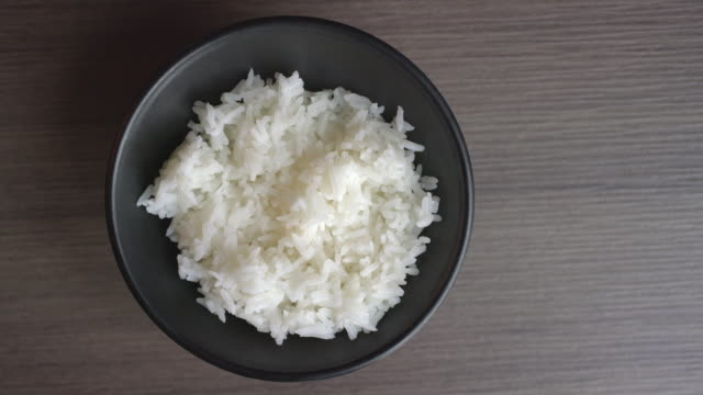 rice in bowl top view - bowl stock videos & royalty-free footage