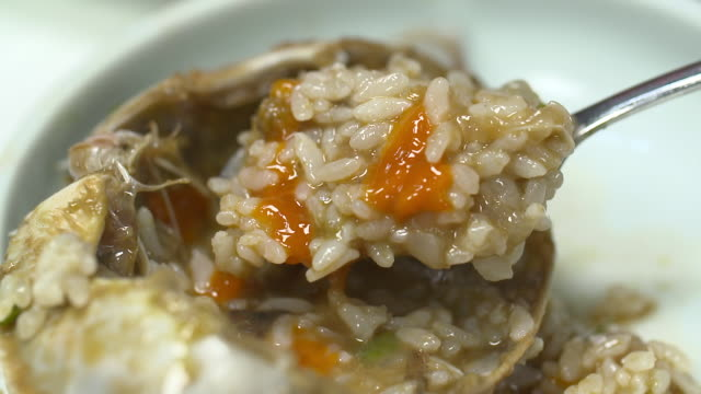 rice mixed with ganjang gejang(soy sauce marinated raw crab) being spooned up - marinated stock videos and b-roll footage