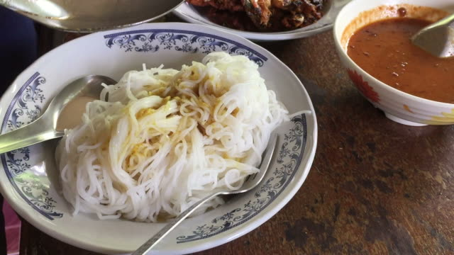 rice noodles in fish curry sauce - thai food stock videos and b-roll footage