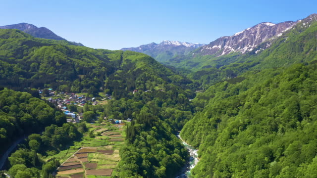 ws aerial rice paddies in valley and mountains, akiyamago, niigata prefecture, japan - satoyama scenery stock videos & royalty-free footage