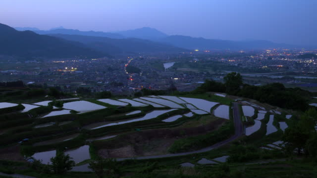 rice terraces (tanada) at dusk,obasute,nagano - plusphoto stock videos & royalty-free footage