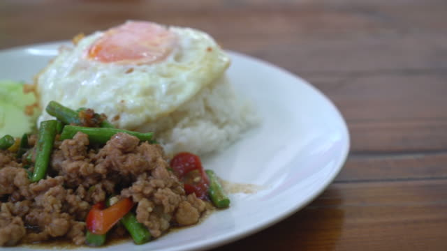 Rice topped with stir-fried minced pork and basil