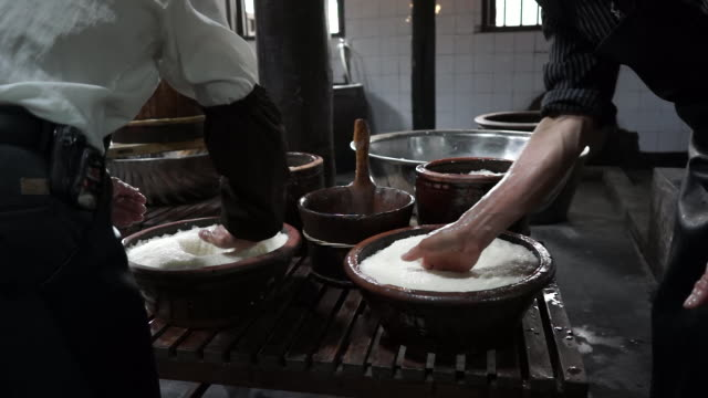 rice wine also known as mijiu is the eastern alcoholic beverage made from rice originated from china - tradition stock videos & royalty-free footage