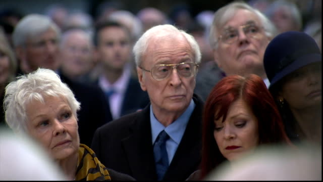 richard attenborough memorial service; wide shots of memorial service and congregation as recording of richard attenborough reading shakespeare's... - penelope keith stock-videos und b-roll-filmmaterial