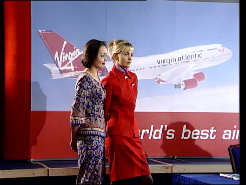 richard brandson concorde bid lib london heathrow virgin and singapore airlines stewardesses at pkf branson and chief executive of singapore airlines... - british aerospace concorde stock videos and b-roll footage