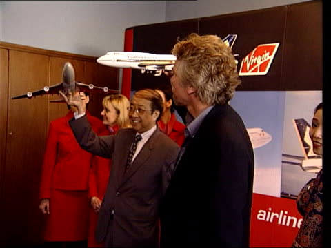 richard brandson concorde bid lib richard branson at photocall with chief executive of singapore airlines at part selloff of virgin airlines - british aerospace concorde stock videos and b-roll footage