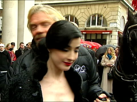 richard branson press conference launch of new virgin media services covent garden piazza branson photocall with dita von teese as copyright music... - dita von teese stock videos & royalty-free footage