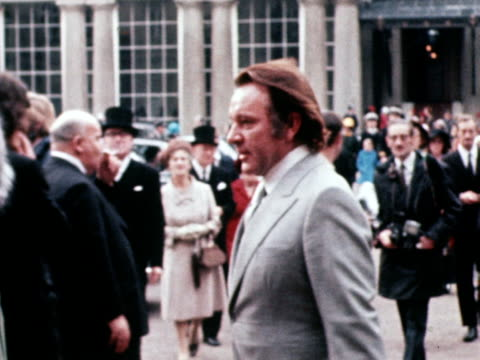 richard burton and elizabeth taylor walk to their rolls royce after burton receives a cbe medal at buckingham palace. november 1970. - rolls royce stock videos and b-roll footage