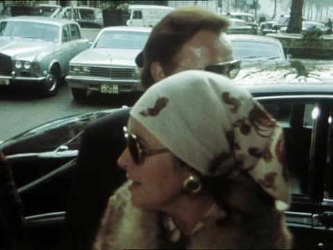 richard burton's 50th birthday; b) england: london: heathrow : elizabeth taylor and richard burton towards in dark sunglasses ext both to car park... - sunglasses stock videos & royalty-free footage