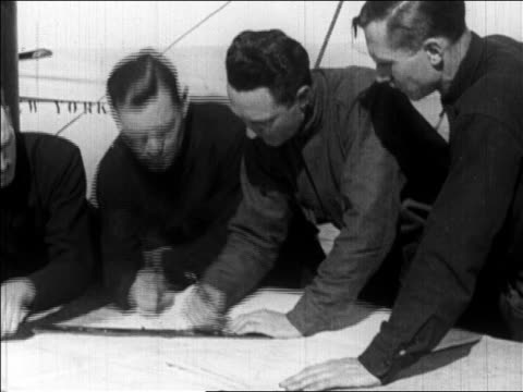 richard byrd + men on deck of ship plotting expedition to the north pole / newsreel - 1926年点の映像素材/bロール