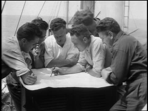 vidéos et rushes de richard byrd on boat with crew planning course to antarctica / documentary - 1928
