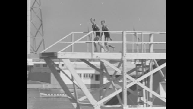 richard degener and marshall wayne do dual somersault dives from high dive platform / note: exact day not known - diving platform stock videos & royalty-free footage