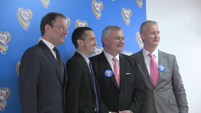 stockvideo's en b-roll-footage met richard desmond martin hall john hume eamonn holmes pose for photos prior to the press conference launching the health lottery group photo at the... - eamonn holmes