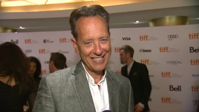 vídeos de stock e filmes b-roll de richard e. grant on having this film written for him, what he loved about the role, how he & jude created such a great on-screen relationship &... - richard e. grant