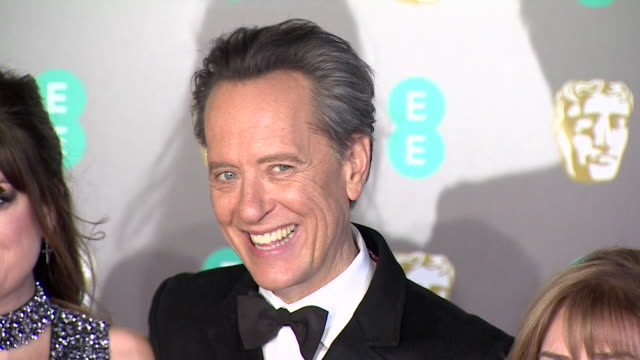 richard e grant poses for photos with wife and daughter on red carpet at bafta film awards at royal albert hall - richard e. grant stock videos & royalty-free footage