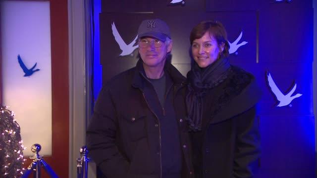 richard gere and carey lowell at grey goose blue door on january 21, 2012 in park city, utah. - グレイグース点の映像素材/bロール