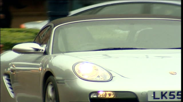 james may hospital visit england leeds leeds central infirmary ext car driven by tv presenter james may leaving hospital pan - richard hammond stock videos & royalty-free footage