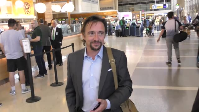 interview richard hammond talks about his favorite car on top gear while departing at lax airport in los angeles in celebrity sightings in los angeles - richard hammond stock videos & royalty-free footage