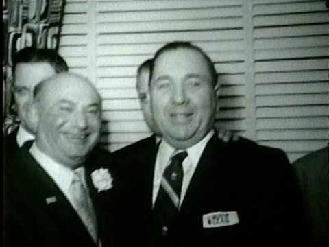 vidéos et rushes de wgn richard j daley poses for pictures wtih treasurer morris b sachs and other supporters after winning the chicago mayor's office on april 5 1955 - 1955
