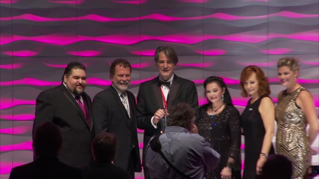 richard leigh accepts sesac songwriter legacy award presented by tim fink, thanks reba mcentire and crystal gayle who've performed his songs at 2015... - crystal gayle stock videos & royalty-free footage