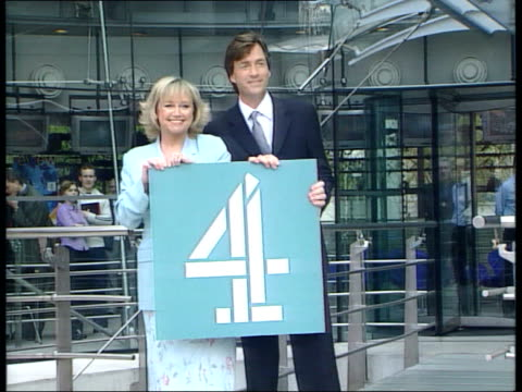 richard madeley and judy finnigan join channel 4 itn london richard madeley and wife judy finnigan towards out of channel 4 hq cms both posing for... - judy finnigan stock videos and b-roll footage