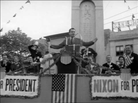 richard nixon at podium making speech at outdoor political rally / michigan / newsreel - richard nixon stock-videos und b-roll-filmmaterial
