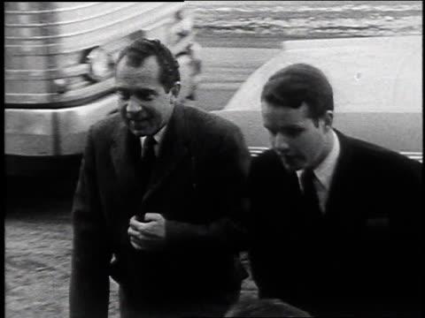 Richard Nixon exiting car and shaking hands / Laconia New Hampshire United States