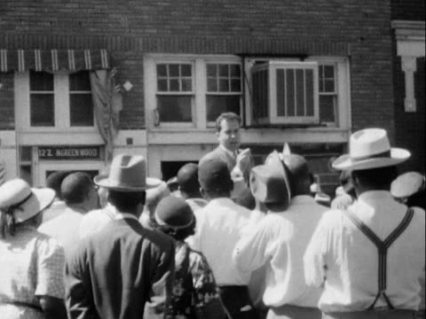 stockvideo's en b-roll-footage met 1953 montage b/w richard nixon giving speech and greeting group of people on street during presidential campaign before leaving in motorcade/ greenwood, tulsa, oklahoma, usa - presidentsverkiezing