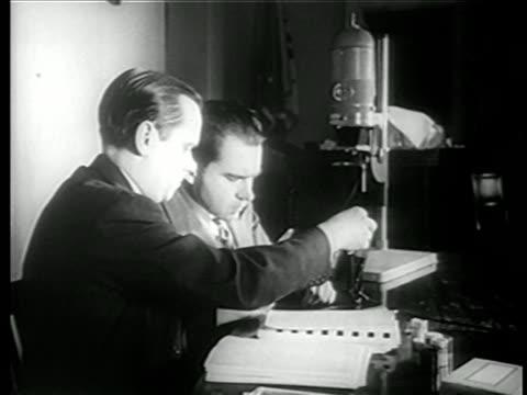 richard nixon robert stripling examine microfilm from chamber's farm / newsreel - richard nixon stock-videos und b-roll-filmmaterial