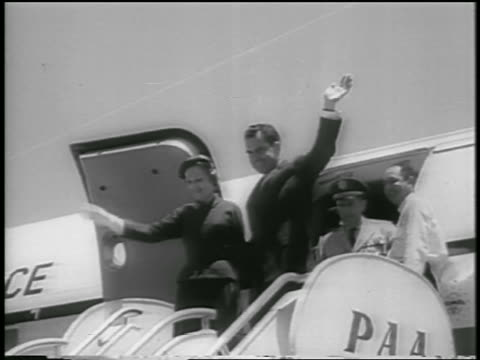 richard pat nixon waving from top of stairs at doorway of airplane / venezuela - mature couple stock videos & royalty-free footage