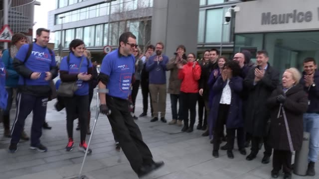 richard pollins begins 40km walk to raise money for research into motor neurone disease; england: london: ext group of people counting down and... - kilometre stock videos & royalty-free footage