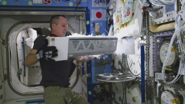 richard r arnold works inside the spaceship the mission of expedition 56 began on 1 june 2018 upon the departure of soyuz ms07 it ended on october 4... - international space station stock videos & royalty-free footage