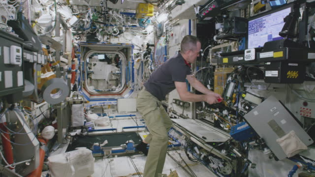 richard r arnold works inside the spaceship the mission of expedition 56 began on 1 june 2018 upon the departure of soyuz ms07 it ended on october 4... - atmosphere filter stock videos and b-roll footage