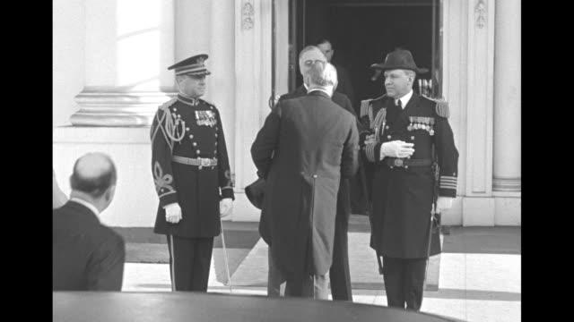 Richard 'R B' Bennett decars upon arrival at the White House walks toward US Pres Franklin Roosevelt Bennett's sister Mildred and her husband William...