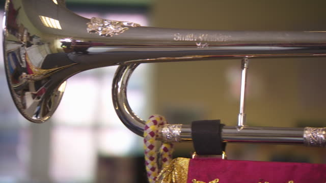 richard smith of 'smithwright' trumpets demonstrating their royal trumpet to be used in the wedding of prince harry and meghan markle - metal blend stock videos and b-roll footage