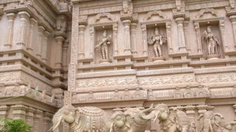 richly decorated facade of the sri shakti dhevasthanam temple bukit rotan, ijok, selangor - female likeness stock videos & royalty-free footage