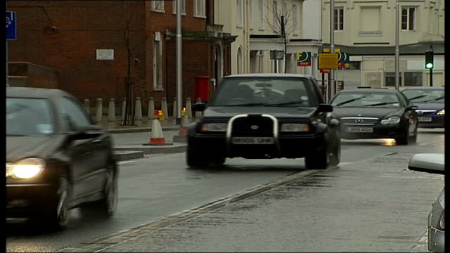 richmond council to continue with plans to link parking permit cost to level of car emissions tx cars along on road including land rover - land rover stock videos and b-roll footage