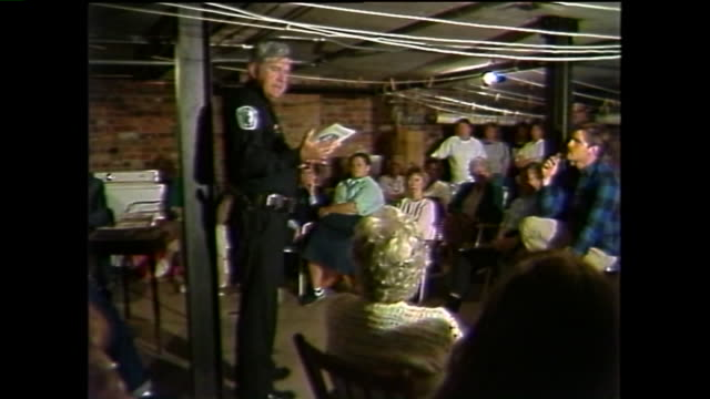 wtvr richmond va police officer speaks at a home security meeting in richmond on october 6 as area residents were in fear of the southside strangler... - throttle stock videos & royalty-free footage