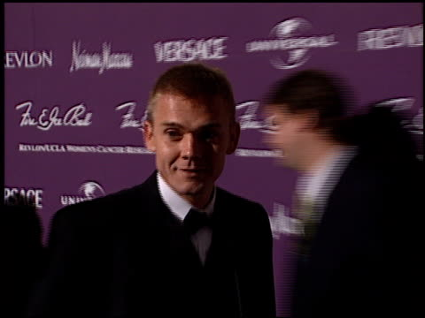 rick schroder at the 1998 fire and ice ball entrances at universal studios in universal city, california on december 9, 1998. - リック シュローダー点の映像素材/bロール