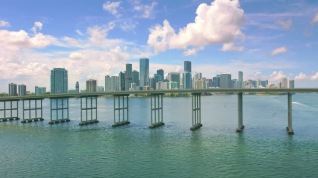 aerial rickenbacker causeway with downtown miami skyline - south beach stock videos & royalty-free footage