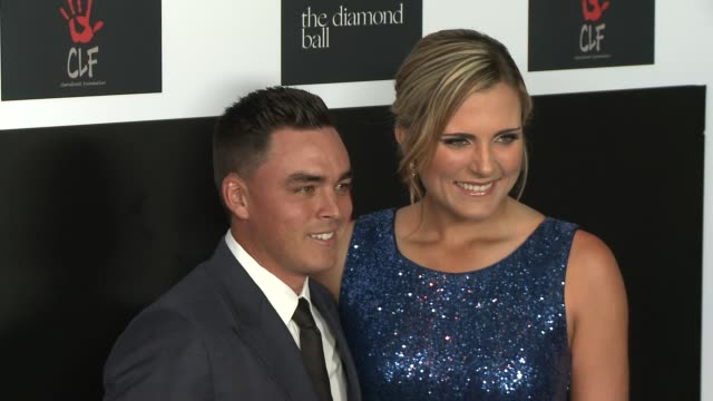 Rickie Fowler and Lexi Thompson at the 2nd Annual Diamond Ball at Barker Hangar on December 10 2015 in Santa Monica California