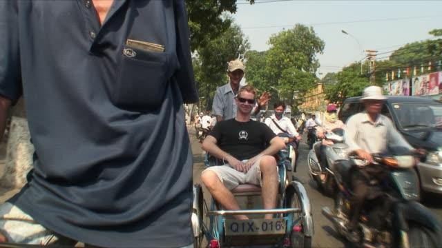 ms pan pov rickshaw ride with traffic, saigon, vietnam - sun visor stock videos & royalty-free footage