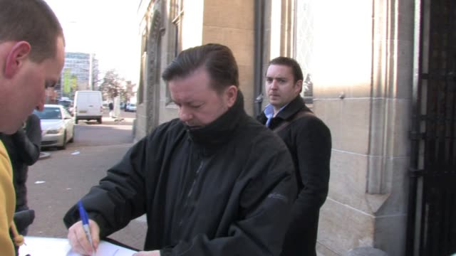 ricky gervais leaves 'this morning' studios on the south bank, london where he was promoting the release on dvd of his film 'the invention of lying'.... - ricky gervais stock videos & royalty-free footage