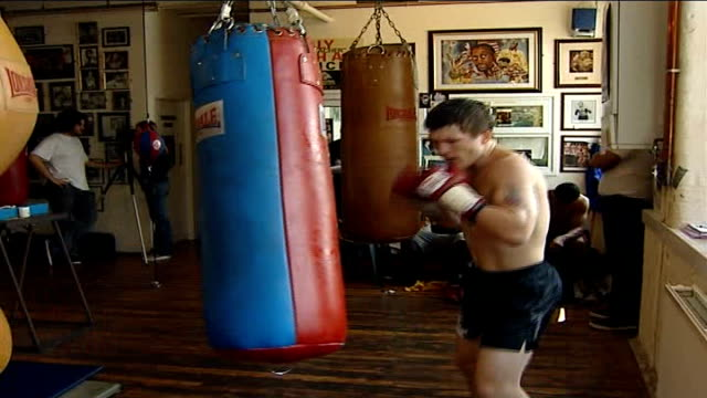 scientific analysis of his left hook before world championship fight england int ricky hatton training with punchbag in gym including poster of hatton - world championship stock videos & royalty-free footage