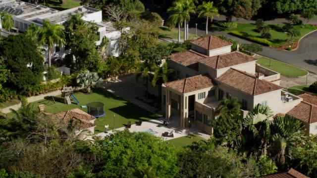 ws aerial pov ricky martin's mansion with backyard pool and kids' trampoline / dorado, puerto rico, united states  - ricky martin stock videos and b-roll footage