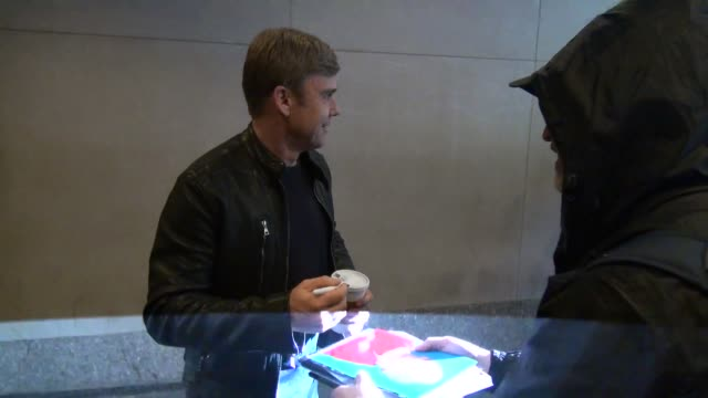 ricky schroder poses for photos and signs for fans outside of the 'today' show on may 18, 2015 in new york city. - リック シュローダー点の映像素材/bロール