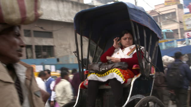 Ricshaw pulled by man in a busy Kolkata Street