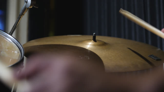 a ride cymbal is hit on a drum kit - cymbal stock videos and b-roll footage