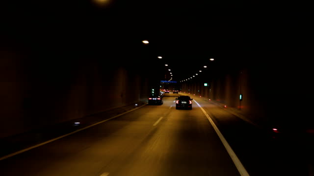 ride on the night by car through the tunnel - tail light stock videos & royalty-free footage